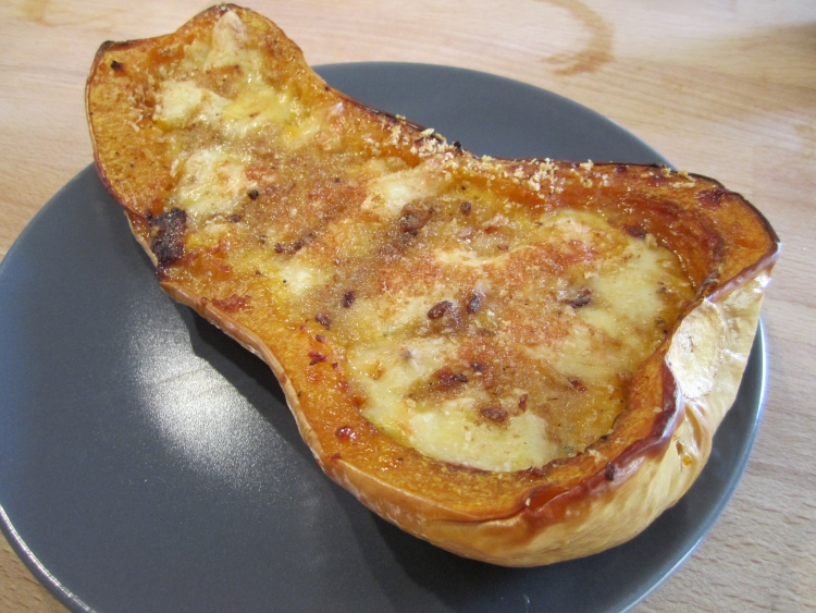 Stuffed butternut squash with creme fraiche, herbs and cheese